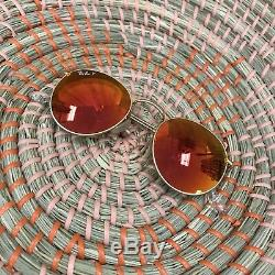 Ray-Ban Round Polarized Sunglasses (Red/Orange Gradient Mirror Lens)